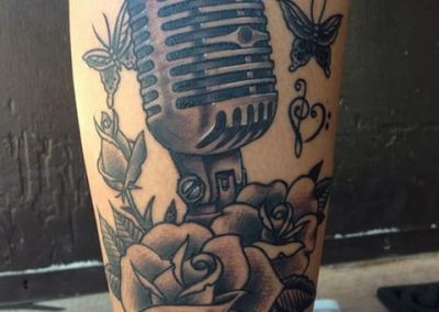 Vintage microphone with roses and butterflies tattoo - by Jared - Maui Tattoo Artist at Mid-Pacific Tattoo
