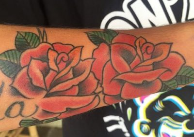 Two red roses tattoo - by Jared - Maui Tattoo Artist at Mid-Pacific Tattoo