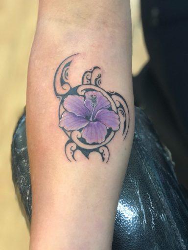 Hawaiian honu turtle with a purple hibiscus tattoo - by Buge - Maui Tattoo Artist at Mid-Pacific Tattoo