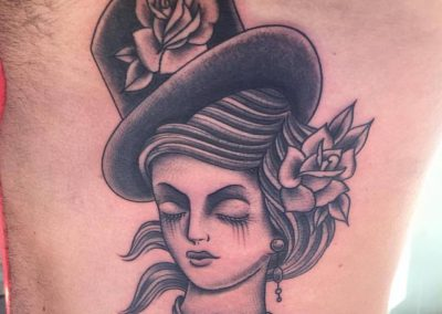 Face of a Lady in a Top Hat tattoo - by Jared - Maui Tattoo Artist at Mid-Pacific Tattoo