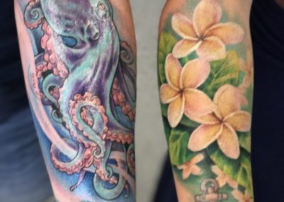 Blue octopus and white plumeria tattoos - by Kaib - Maui Tattoo Artist at Mid-Pacific Tattoo