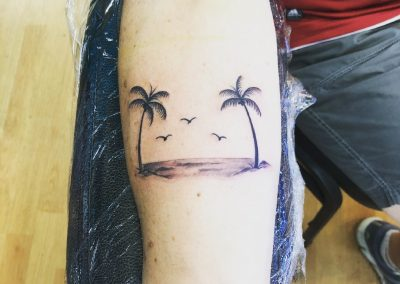 Black and grey palm trees tattoo - by Buge - Maui Tattoo Artist at Mid-Pacific Tattoo