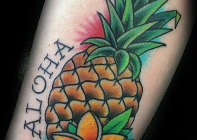 Pineapple and plumeria tattoo - by Matt - Maui Tattoo Artist at Mid-Pacific Tattoo