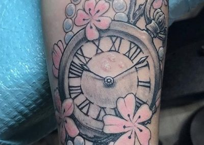 Clock with cherry blossoms tattoo - by Bob - Maui Tattoo Artist at Mid-Pacific Tattoo