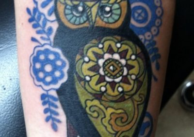 Colorful owl tattoo - by Bob - Maui Tattoo Artist at Mid-Pacific Tattoo