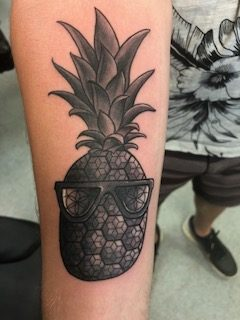 Black and grey pineapple with sunglasses tattoo - by Curtis - Maui Tattoo Artist at Mid-Pacific Tattoo