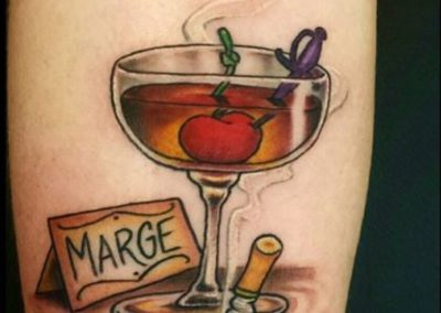 A glass of whiskey and a cigarette tattoo - by Curtis - Maui Tattoo Artist at Mid-Pacific Tattoo