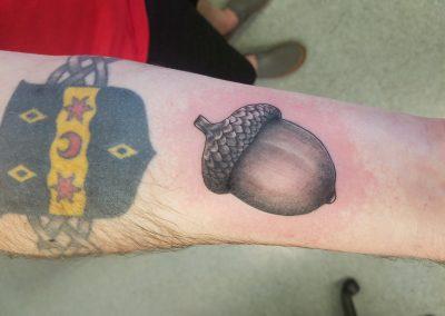 Black and grey acorn tattoo  - by Bry - Maui Tattoo Artist at Mid-Pacific Tattoo