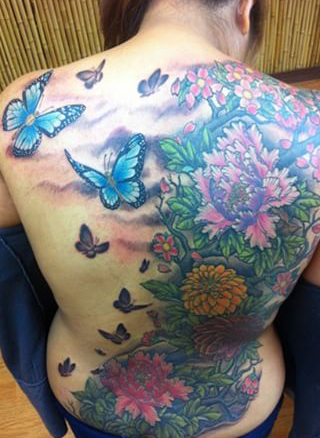 Flowers and butterflies full back tattoo - by Tommy - Maui Tattoo Artist at Mid-Pacific Tattoo