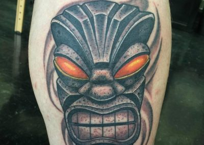Tiki with glowing eyes tattoo - by Tommy - Maui Tattoo Artist at Mid-Pacific Tattoo