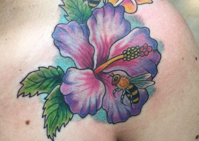 Purple plumeria with bees tattoo - by Dani - Maui Tattoo Artist at Mid-Pacific Tattoo
