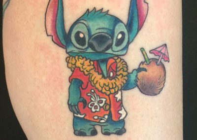 Stitch in an aloha shirt tattoo - by Dani - Maui Tattoo Artist at Mid-Pacific Tattoo