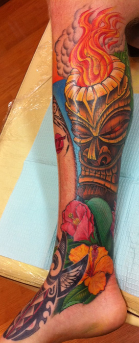 Maui Tiki tattoo with floral and Polynesian elements - by Tommy - Maui Tattoo Artist at Mid-Pacific Tattoo