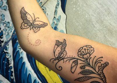 Black Botanical line work tattoo by Camila - Maui Tattoo Artist at Mid-Pacific Tattoo