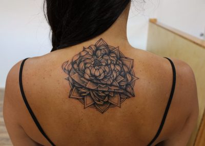Black and Grey flower tattoo with dot work by Jacob - Maui Tattoo Artist at Mid-Pacific Tattoo