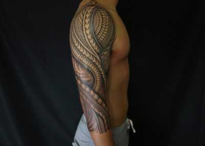 Polynesian tribal shoulder and arm tattoo by Jacob - Maui Tattoo Artist at Mid-Pacific Tattoo