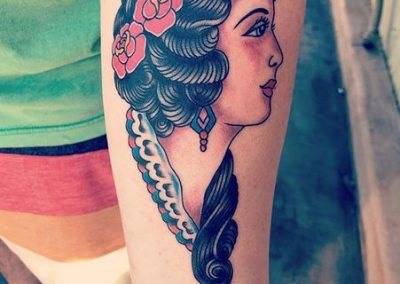 Girl with a flowers in her hair tattoo by Maui Tattoo artist Noah at Mid-Pacific Tattoo
