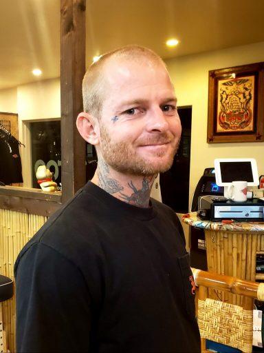 Noah, tattoo artist at Mid-Pacific Tattoo, in Lahainaluna location in Lahaina, Maui, Hawaii.